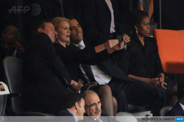 image of president obama at mandela memorial